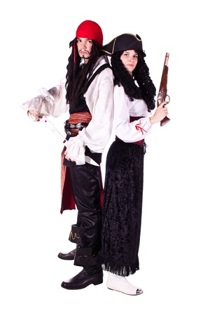 A man and a woman dressed as a pirate, pistol and saber. White background. Studio photography. Editorial