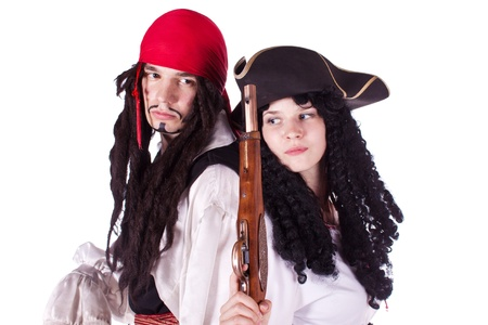 A man and a woman dressed as a pirate, pistol and saber. White background. Studio photography.
