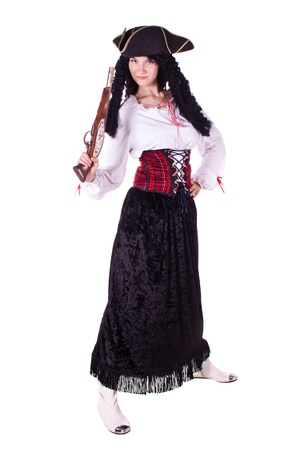 A woman dressed as a pirate, pistol and saber. White background. Studio photography.