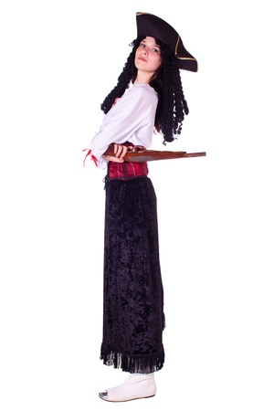 A woman dressed as a pirate, pistol and saber. White background. Studio photography. Stock Photo - 10067891