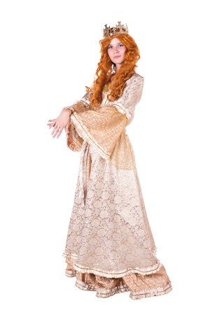 Girl dressed as princess with a crown. White background.
