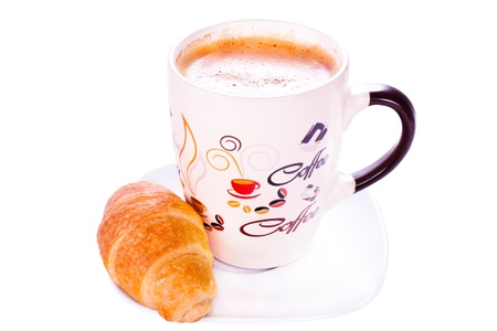 Cup of coffee and chocolate croissant on white background photo