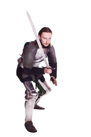 Shooting in a studio in the armor, and people with weapons. photo