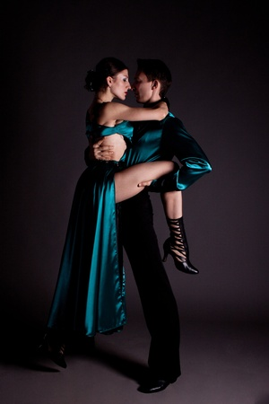 Studio shooting on a black background, the dancers in costume. Stock Photo