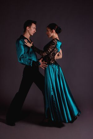 Studio shooting on a black background, the dancers in costume. photo