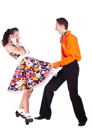 Studio fotografie op een witte achtergrond, dansers verkleed als rock and roll. Stockfoto