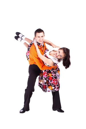 twist: Studio photography on a white background, dancers dressed as rock and roll.