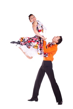 Studio photography on a white background, dancers dressed as rock and roll.