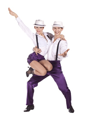 Studio photography on a white background, dancers dressed as rock and roll. photo