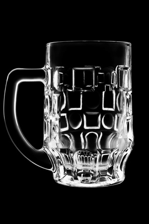 empty glass on a black background. Shoot the glass on a black background photo
