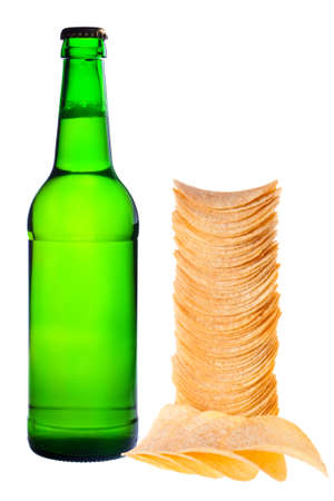 A bottle of beer and chips. Photographed on a white background. photo