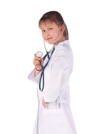 girl, a doctor, the child. Children dressed as doctors, nurses photo