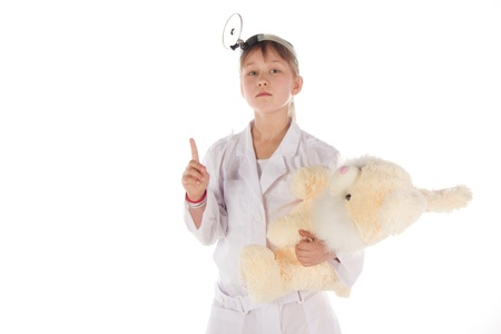 girl, a doctor, the child, rabbit toy. Children dressed as doctors, nurses Stock Photo - 12990815