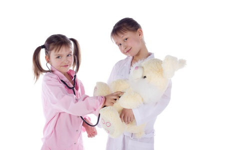 girl, a doctor, the child, rabbit toy. Children dressed as doctors, nurses Stock Photo - 12991306