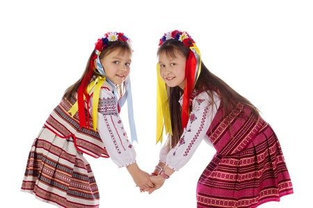 A child, two girls in a bright dress  The child in the popular, bright, suit photo