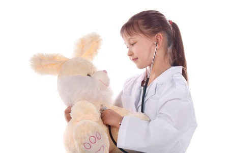 girl, a doctor, the child, rabbit toy. Children dressed as doctors, nurses Stock Photo - 12991229