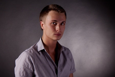 portrait of a man. gay. black Background photo