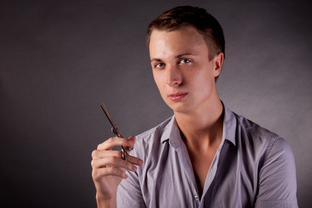 The barber man. Scissors, comb. black Background Stock Photo - 13318557