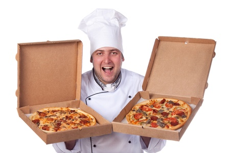 male chef holding open two boxes of pizza photo
