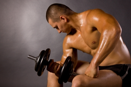 Muscled male bodybuilderweight, dumbbell, raise, swing Stock Photo - 15370167