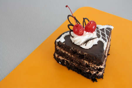 spoiling: harmful cake on the orange stand