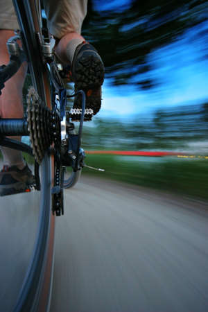 panning: Speeding on the bike  Sharp derailleur and motion blurred background  panning effect  Stock Photo