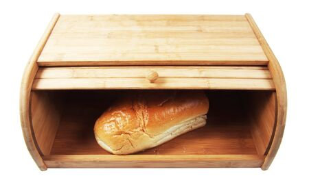 breadbasket: wooden breadbasket with loaf of breas isolated closeup