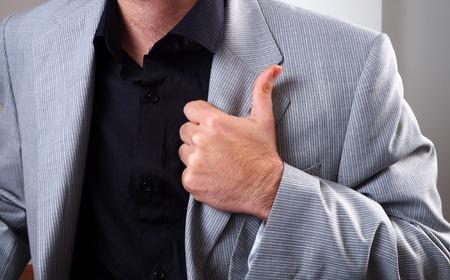 superior: young man body language superior closeup