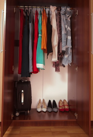 hanged: wardrobe with hanged clothes and shoes closeup Stock Photo