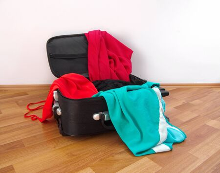 open suitcase: open suitcase with female clothes closeup