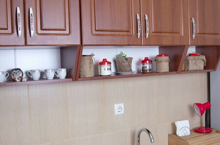 cabinets: wooden kitchen cabinets and shelf closeup