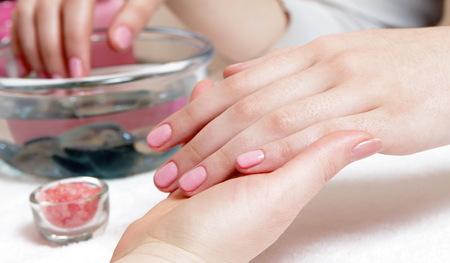 female gentle pink manicure closeup