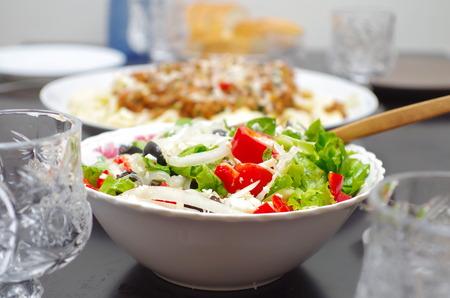 freshly prepared: Freshly prepared Greek salad on a serve table closeup Stock Photo