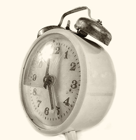 age 5: Vintage alarm clock isolated closeup