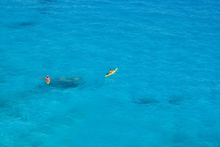 limpid: Canoeists in the sea to Goloritzè cove in Sardinia, Italy