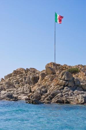 Italian flag on the rock photo