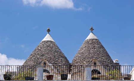 Limestone dwellings with dome  trulli  in Alberobello, Apulia  Italy Stock Photo - 13609978