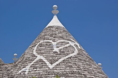 Limestone dwellings with dome  trulli  in Alberobello, Apulia  Italy  photo