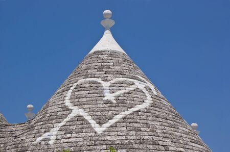 trulli: Limestone dwellings with dome  trulli  in Alberobello, Apulia  Italy