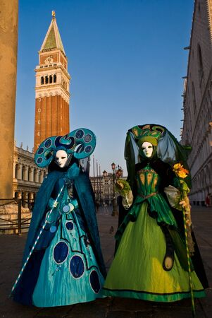 canal parade: A pair of masks in Venice, Italy