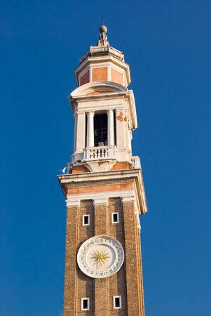Bell Tower of Santi Apostoli Church in Venice, Italy photo