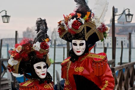 A pair of masks in front of Venice lagoon, Italy