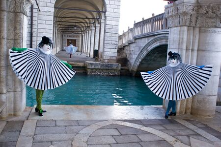 Three masks near a channel in the Venice lagoon, Italy Stock Photo - 13512727