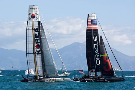 america's cup america: Naples, Italy - April 11-15, 2012 - Oracle Racing and Korea Team catamarans in America Cup World Series in the gulf of the Naples Editorial
