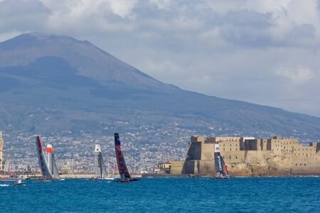 america's cup america: Naples, Italy - April 11-15, 2012 - A fleet race in America Cup World Series in gulf of Naples with the vulcan Vesuvius in background Editorial