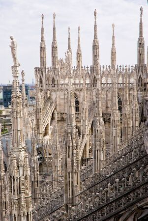 gargoyles: A view of the spiers of the Milan cathedral in Italy, Europe Stock Photo