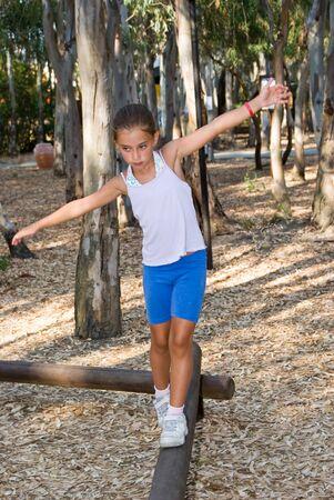 balance beam: Girl walking on the balance beam Stock Photo