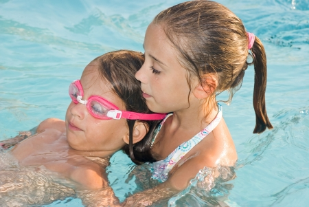 Girls who teaches swimming to another girl photo