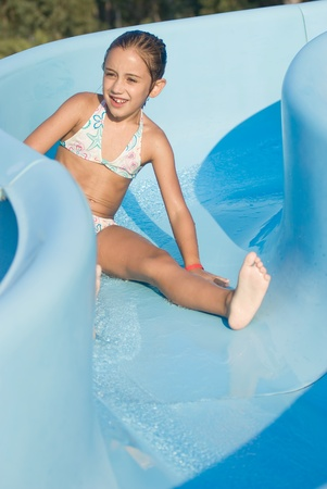 Girl on a water slide photo