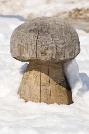 bark carving: Wooden sculpture in the snow Stock Photo